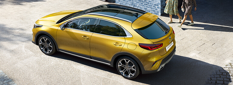 yellow kia xceed from top
